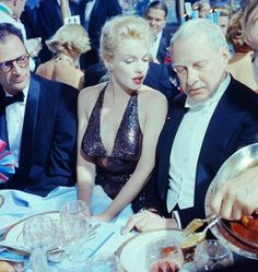 "Marilyn Monroe & Arthur Miller at the ""April in Paris"" ball at the Waldorf Astoria Hotel, New York, April"