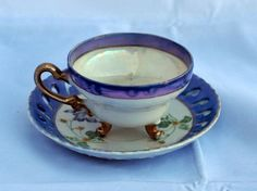 Vintage 3 footed tea cup and saucer roses purple iridescent trim