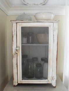 Cabinet, bowl and mason jars.