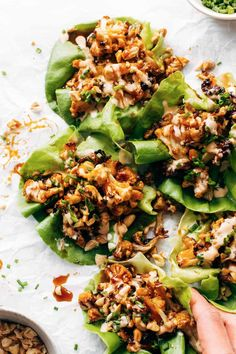 Korean BBQ Style Cauliflower Lettuce Wraps! Crispy roasted cauliflower tossed in a sweet and sticky Korean BBQ sauce, all topped with chives, peanuts, and spicy mayo. YUM. #vegetarian #vegan #healthyrecipe | pinchofyum.com