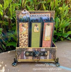 """Graphic 45 Safari Adventure Mini Album Trio Set By Ginger Ropp - My Sisters Scrapper   """"I used the gorgeous Graphic 45 Safari Adventure DCE to create a great mini album project for Father's Day. The Deluxe Collector's Edition includes all of the gorgeous papers, chipboard, and stickers. This trio of mini-albums would be great to hold all of the amazing summer vacation photos.   I added lots of Graphic 45 metal embellishments on this project and the Gold Gloss Architecture Washi Tape was… Safari Adventure, Graphic 45, Antique Metal, Journal Covers, Metal Stamping, Mini Albums, Vintage Photos, Card Stock, Decorative Boxes"""