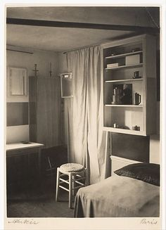 A Corner of Mondrian's Studio with Bed, Stool, Curtain, and Mirrors. 1926.  Taken by André Kertész