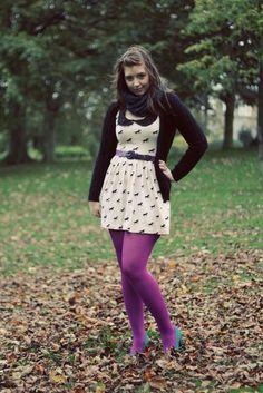 Kicking leaves in purple pantyhose and blue heels