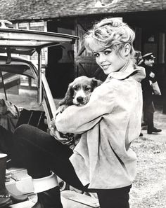 Brigitte Bardot with a puppy during the making of La Parisienne, 1950