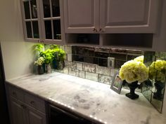Antique mirror tiles create a one of a kind backsplash for a contemporary or traditional kitchen. Tiles are custom cut to any size! We can safely ship to you!
