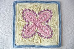 This pattern uses an unusual floral motif, lace, shells and post stitches to create a unique 12 inch square.