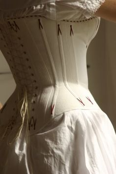 A lovely example of cording + boning in an early-bustle-era corset. This goes far to reduce ripples in fabric and helps create a beautiful shape. Via Before the Automobile.