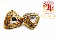 Shine in these stunning studs by kishan lal jewellers.