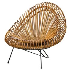 Basketware lounge chair, designed by Janine Abraham & Dirk Jan Rol and produced by Edition Rougier, 1955. / 1stDibs