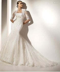 This beautiful lace dress has a definite Spanish feeling: we love the 3/4 sleeve bolero!