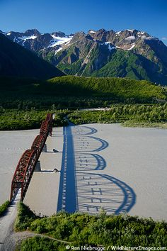 Million Dollar Bridge with a perfect shadow on the Copper River, Cordova, Alaska