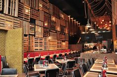 Kaper Design; Restaurant & Hospitality Design Inspiration: Fish Shack Lighting behind pallets!  Could be anything; idea could be dressed up or down.