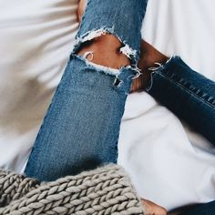 ripped jeans and chunky sweater