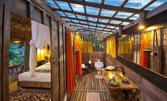"""Since we're an an """" #Indonesia """" mood today, how's this #resort for a #getaway? Yup! Knew you'd love it!   Babmbu Indah #hotel in Ubud: Eco-luxury boutique with stunning panoramic views & cozy artistic bamboo bungalows... you ok with glass floors & a rain shower?"""
