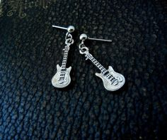 Silver guitar earrings. #fashion #style #jewelry #earrings #music #guitars #musicfashion http://www.pinterest.com/TheHitman14/music-jewelryaccessories-%2B/