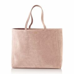 A chic suede tote with monogram detail.