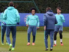 Willian cracks a smile at training