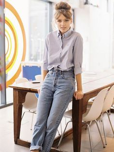 high waisted jeans + all buttoned loose shirt + topknot with center part bangs + cat eye + oxfords