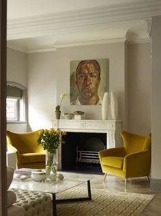 Chairs and art provide perfect focal point in this living room.