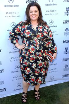 Melissa McCarthy lookin' fab in our ASOS Curve #floral wrap dress http://asos.to/1eCaPy3