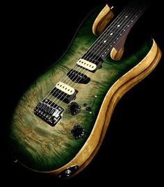 Suhr Modern in Faded Trans Green Burst - Waterfall Burl Maple top, Black Limba body, Cocobolo neck with Ebony fingerboard.