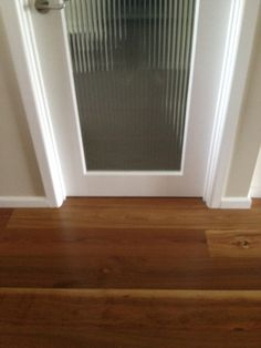 Spotted gum floor, white trims, Grand Piano walls (Dulux) single light door with broadline glass