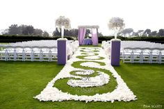 Custom floral aisle runner, gorgeous altar pieces….simply stunning outdoor ceremony