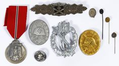 Lot 351: World War II German Infantry Badges; Ten items including wound badges, close combat clasp, infantry assault badge and a winter campaign in Russia medal
