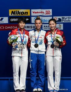 Gold medalist Tania Cagnotto(C) of Italy, Silver medialist Shi Tingmao(L) and Bronze medialist He Zi of China pose at the awarding ceremony after the 1m Springboard Women's diving final at the 2015 Swimming World Championships in Kazan, Russia, July 28, 2015. http://www.chinasportsbeat.com/2015/07/chinese-athletes-win-diving-silver