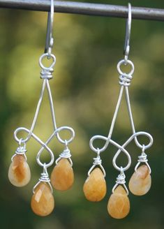 Warm honey colored faceted jasper briolettes are wrapped with sterling silver wire and dance beneath hand formed sterling silver wire triple dangle findings. These delightful earrings are 2 1/4 long from the tops of my handmade sterling silver ear wires. The golden mottled jasper beads