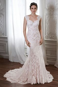 This lace sheath wedding dress is is the epitome of romance. Maggie Sottero, Spring 2015
