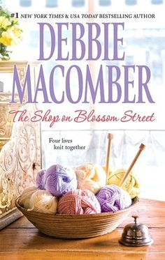 The Shop on Blossom Street (Blossom Street Series #1)  Ever read Debbie Macomber?  She's great, especially if you love series books.  The Blossom Street series follows a group of women who become great friends and supporters, joined by a knitting club.  I have loved all of them.