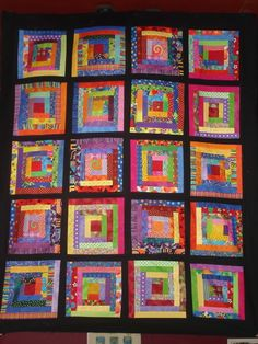 Bright log cabin with black sashing. I wanna make a quilt someday. I made a small one in Home Ec, but I mean a real one like my relatives used to make.
