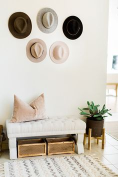 For an untraditional and bohemian décor detail, arrange hats as wall art in an entryway or bedroom