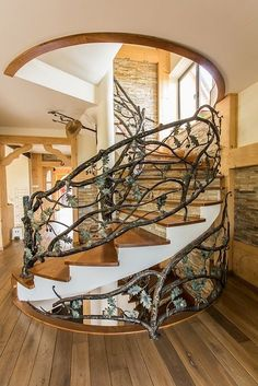 A decorative wrought iron staircase on spiral stairs Staircase Railings, Staircase Design, Stairways, Staircase Ideas, Banisters, Iron Staircase, Spiral Staircases, Escalier Art, Escalier Design