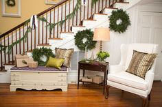 Hang wreaths along the base of your staircase. Tie fresh garland with ribbons + decorative trimming along the railing. Spite House, Entrance Hall, Fresh Green, Blue Design, Ribbons, Christmas Holidays, Garland, Design Inspiration, Base