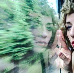 Train Window reflection of singer Andrea Ramolo