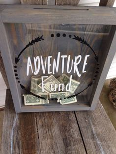 What a great way to watch your money grow for the vacation or honeymoon you have been planing. ---------------------------- This Adventure Fund shadow box is built out of yellow pine and clear acrylic, finished with a weathered gray stain. The lettering on the box is a high