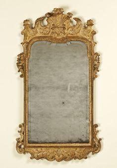 "George I Mirror. Carved & Gilt Wood & Gesso and Mirrored Glass. England. Circa 1720. 47"" x 26"" (120cm x 66cm)."