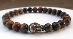 Popular mens gemstone Buddha bracelet is made with 8mm Tiger Eye and an antique brass tierra cast Buddha bead. Tiger Eye Properties: Helps to keep you focused, centered and grounded. It is also benefi