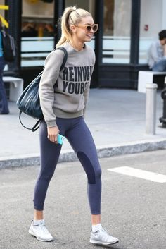 Gigi Hadid.. Valley Eyewear Sunglasses, Farah Khan Reinvent Yourself Sweater, Elizabeth & James Cynnie Sling Bag, and Nike Flyknit Lunar2 Sneakers..