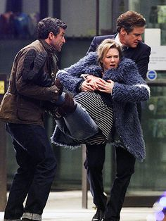 Star Tracks: Tuesday, December 15, 2015   CARRY ON   Is three a crowd? Renée Zellweger gets carried by Patrick Dempsey and Colin Firth while filming a scene for the upcoming Bridget Jones's Baby in London.