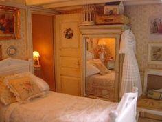 Dollhouse miniature bedroom. Shabby chic. Petit point needlepoint pillow, bed, dress, mirrored wardrobe.