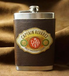 For the gentlemen of the manly sort, this leather-wrapped flask celebrates whiskey drinking and cigar smoking. The stainless steel flask holds up to eight ounces of your favorite spirit, and it's wrapped with soft leather in a dark brown hue. Then the flask is finished with a vintage cigar box label featuring the Captain Alvarez branding, for a vessel that resembles a large cigar, even giving off the mixed aromas of leather and tobacco.