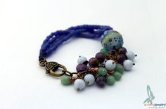 Berries - Beautiful, unique charm bracelet in purple and green, with gemstones, lampwork glass and seedbeads