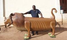 Ghanian coffin artist Paa Joe with a lion coffin.