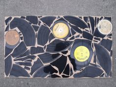 DIY broken record/vinyl art | definitely could get funky with some surfaces...