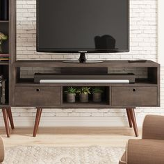 Brayden Studio Marlena TV Stand for TVs up to 50 Color: Terrarum Walnut Modern Tv, Modern Industrial, Tv Media Stands, Wood Drawers, Wood Construction, Adjustable Shelving, Entertainment Center, Storage Spaces, New Homes
