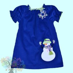 Le' Za Me Reversible short sleeved Bishop Dress with snowman applique on the front and pair of mittens applique on the reverse side. Visit www.hidenseekboutique.com to order.