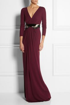 Gucci, Belted jersey Gown, Jersey is an unexpected choice for an evening gown, but Gucci makes it feel so elegant and feminine. This burgundy design has a flattering gathered empire waist, a sweeping skirt and an optional bead and crystal-embellished velvet belt.